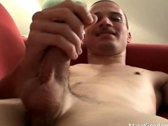 Cute gay dude works his huge shaft