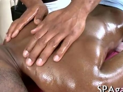 Oiled up black stud gorges on his masseurs cock