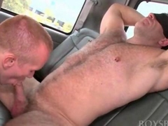 Muscled guy gets gay blowjob while blindfolded in the bus