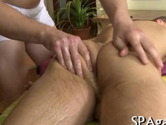 Deep blowjob for a gay boy on the massage table
