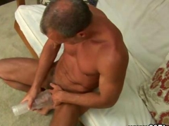 Mature solo stud fucks a slippery flesh light toy