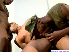 Two gay army officers play with their prisoner