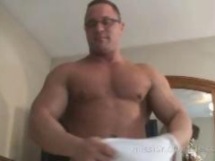 Muscle guy Jerking off his very engorged pecker