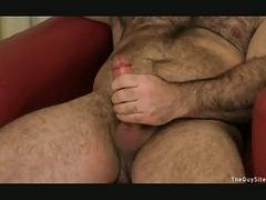 Bearded gay hunk jerks off his fat boner
