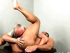 Muscled gay stud gets his ass licked on massage table