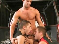 Three young and lusty gay fellas suck hard cocks in threesome sex in garage