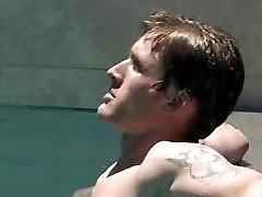 Muscle man with tattoo masturbating in pool